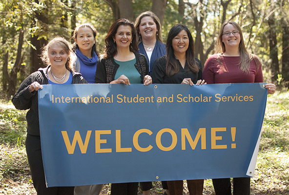 ISSS team with welcome banner